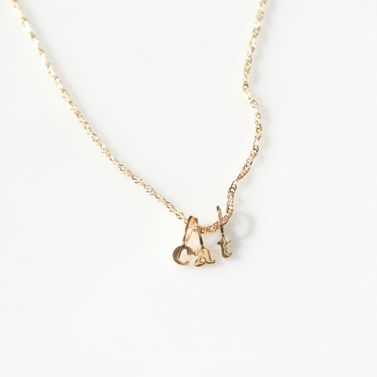 Tiniest Alphabet Charm, Yellow Gold image
