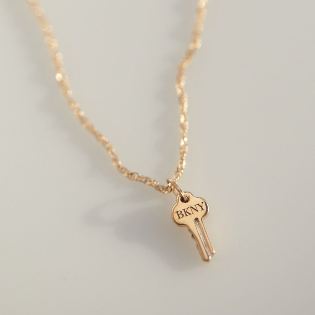 Tiniest Key Charm, Yellow Gold image